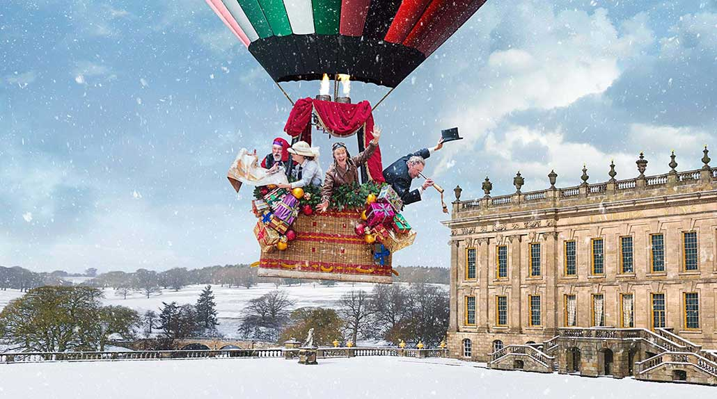 Hot air balloon over snowy Chatsworth House