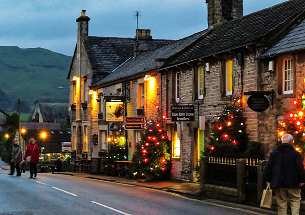 Castleton decorated with Christmas lights and trees
