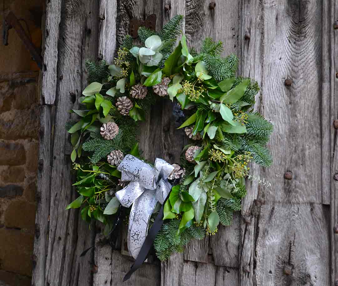 Derbyshire Christmas wreath on wooden door