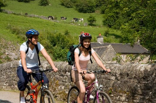 2 people cycling at Wetton Mill