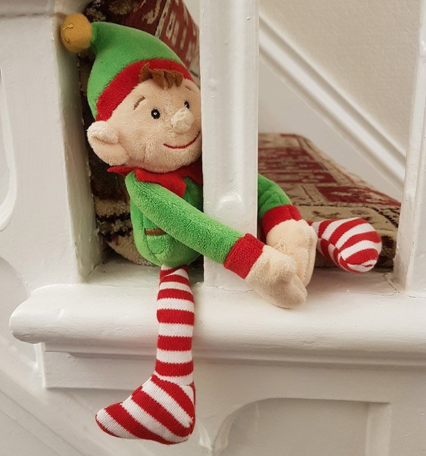 Christmas elf decoration on stairs