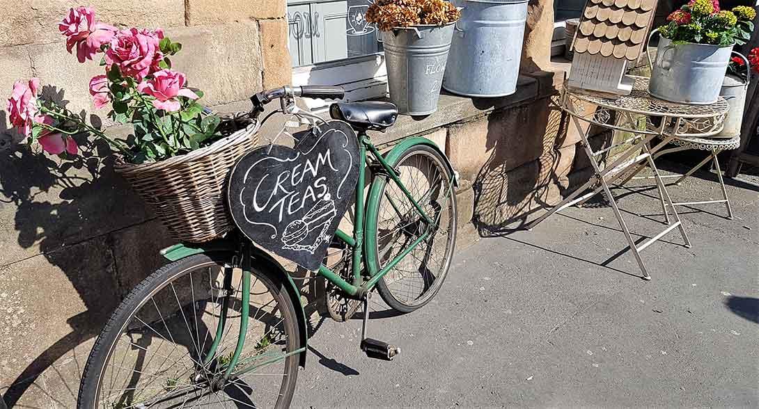 Vintage bicycle advertising Matlock cafe