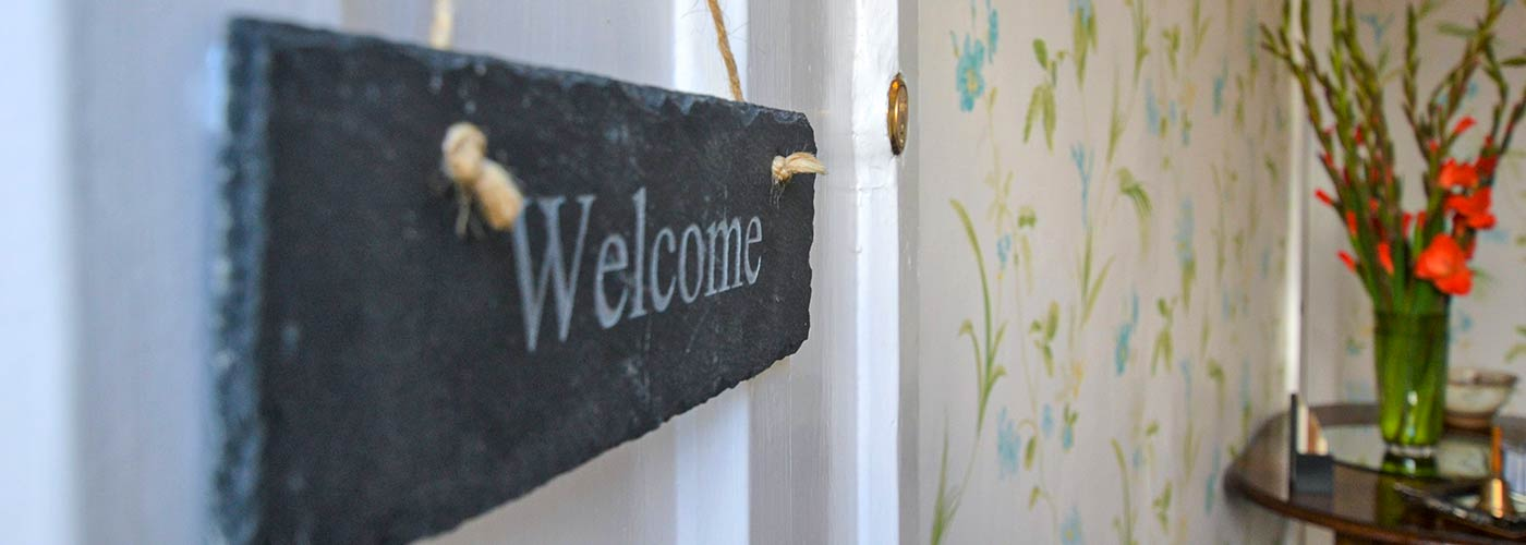 Welcome to Glendon slate sign on door