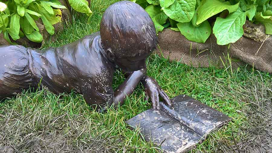 Sculpture of a boy with a book