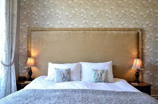Double bed with green leaf cushions