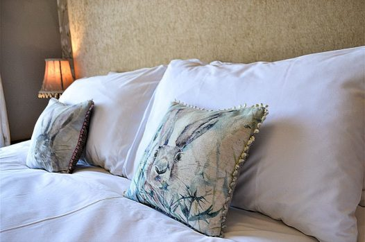 Closeup of double bed cushions and pillows