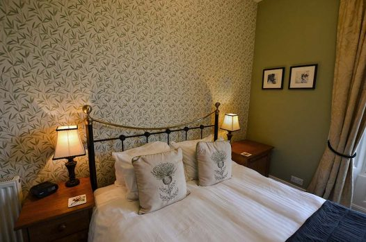 King size bed with bedside tables and lit lamps