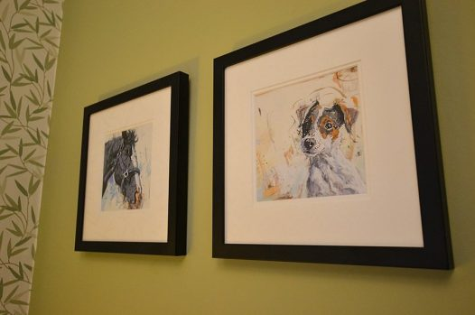 Watercolour pictures of horse and dog on green wall