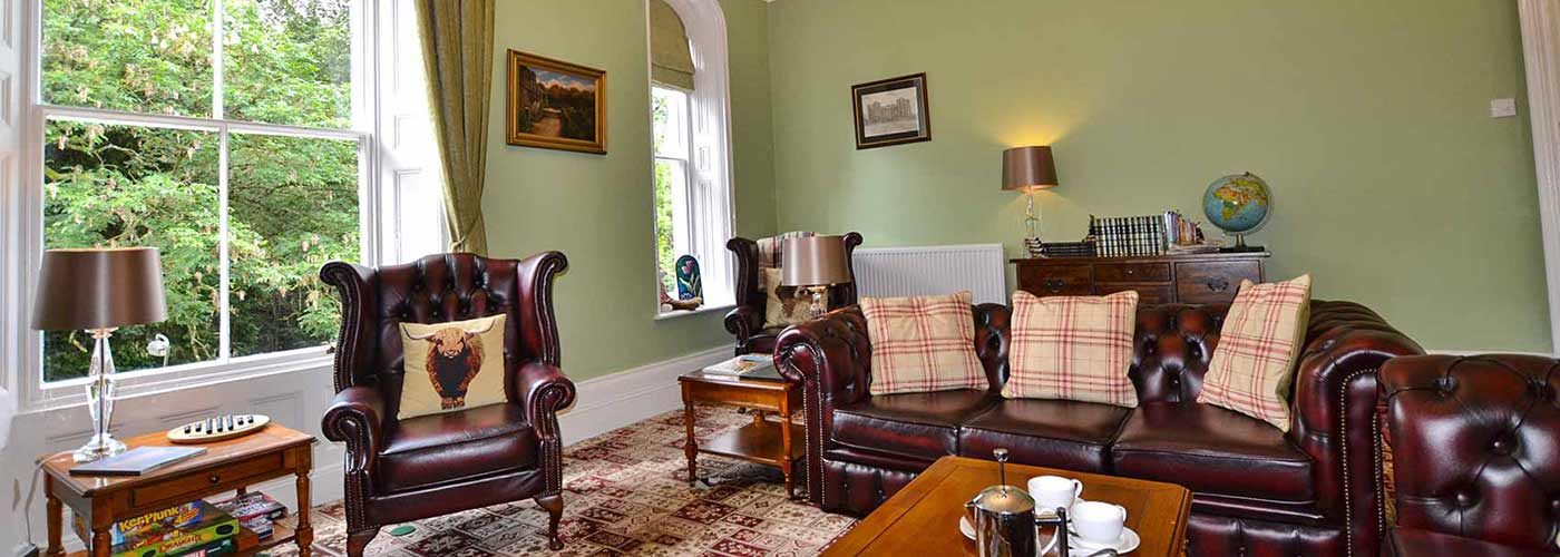 Glendon Guest sitting room with leather sofas and chairs