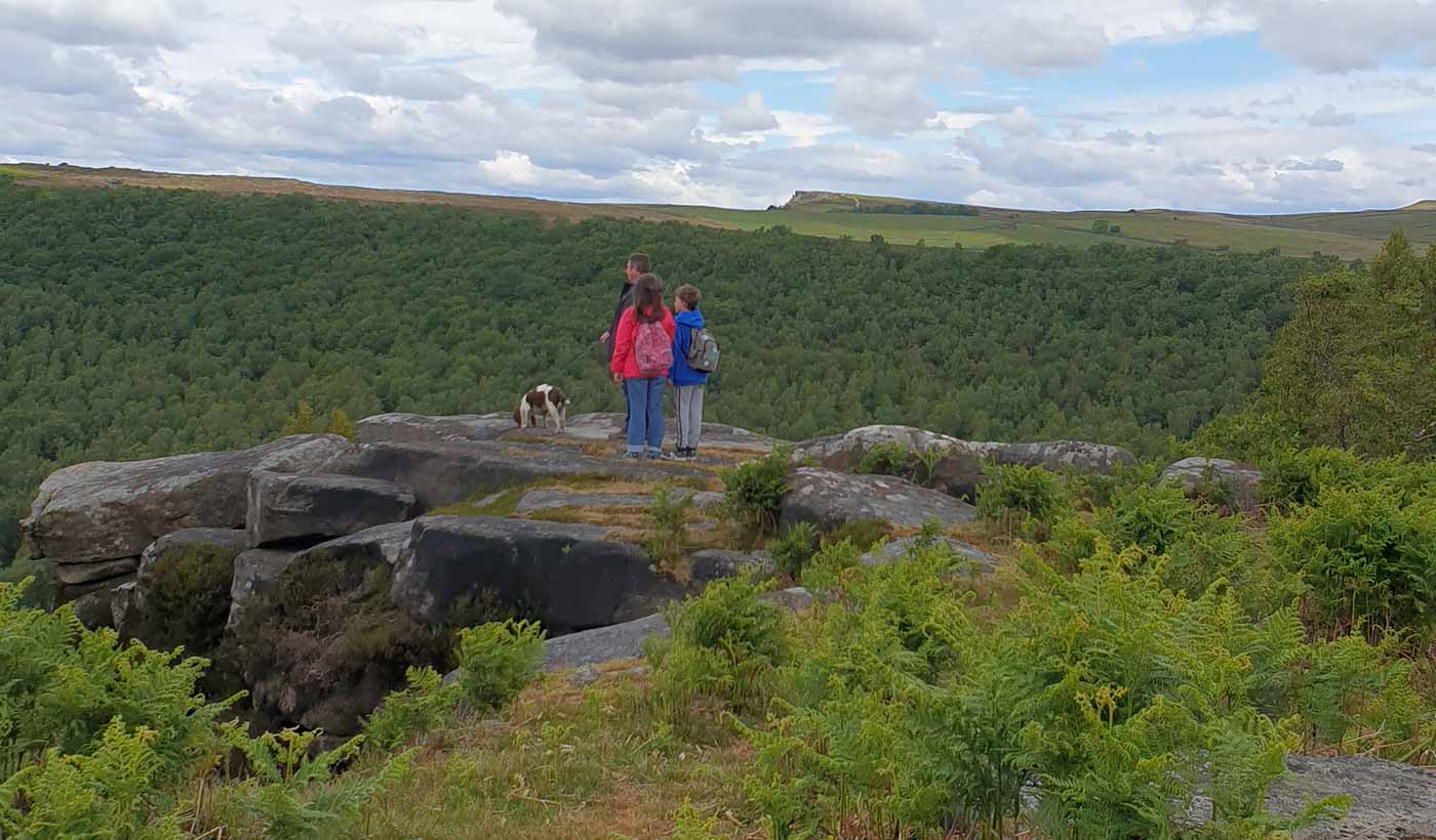 Family walking at Birchen Edge in Derbyshire