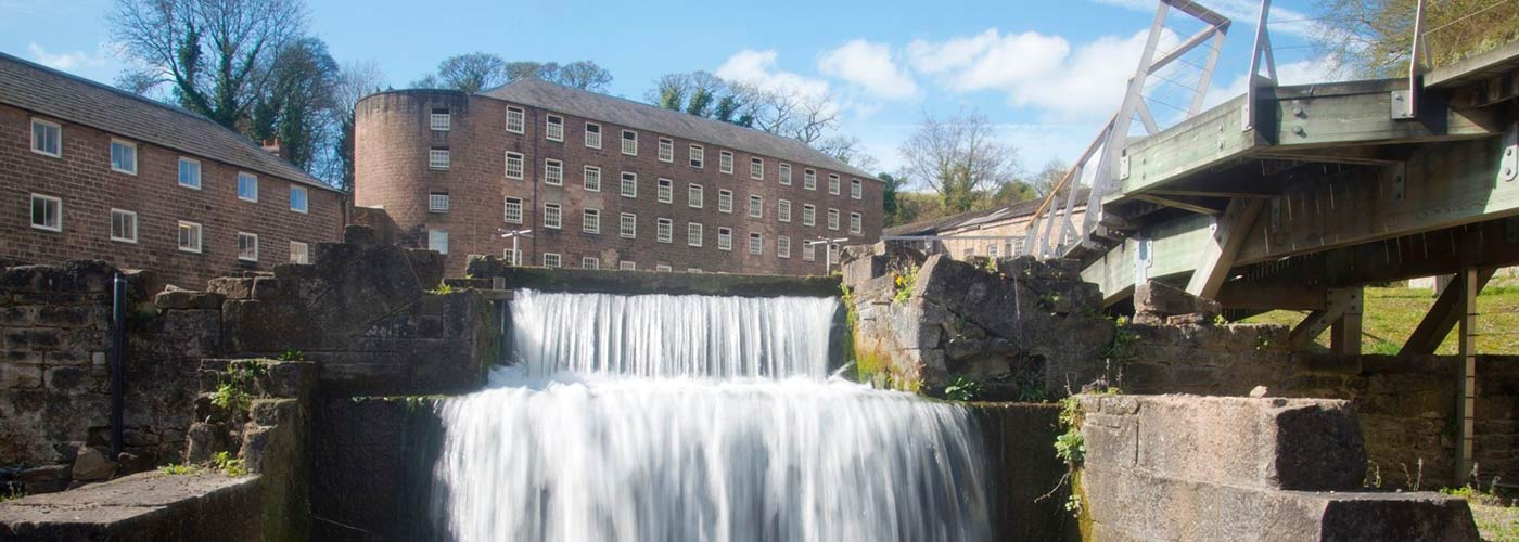 Cromford Mills with waterfall