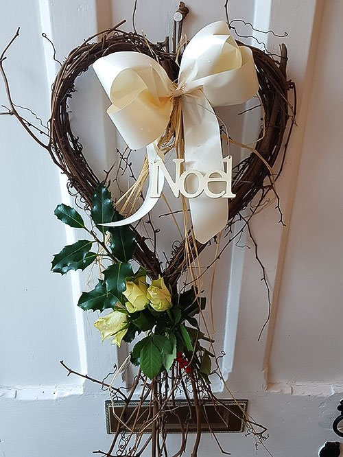 Christmas wreath decorated with flowers and berries