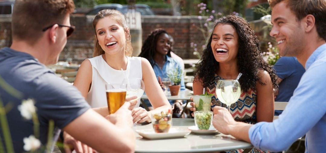 People laughing in pub garden
