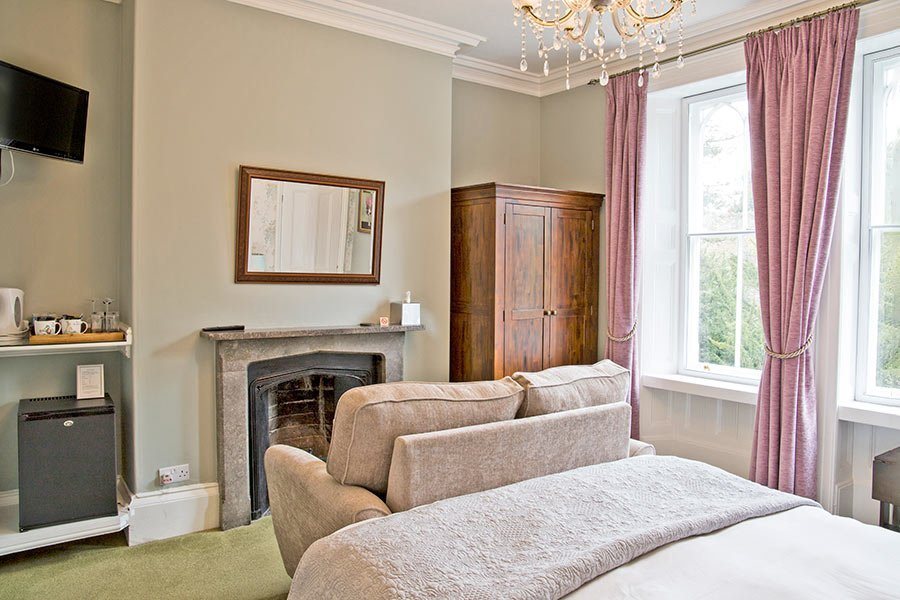 Premier bedroom sofa and fireplace