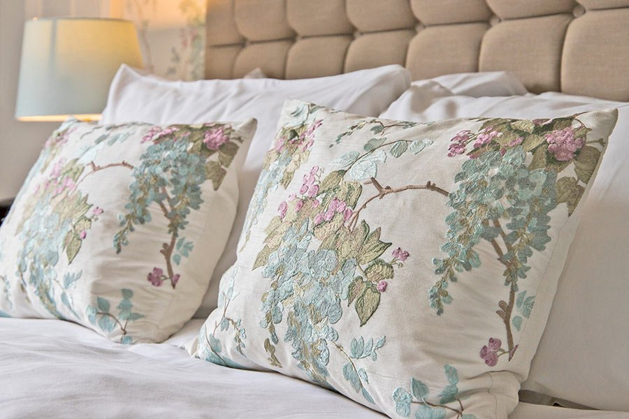 Tapestry pillows on premier room bed