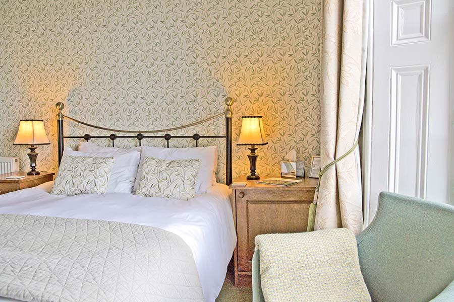 Brass headboard double bed