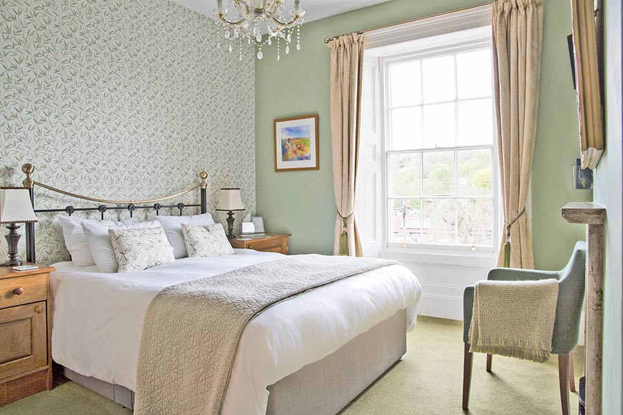 View of double bed and window