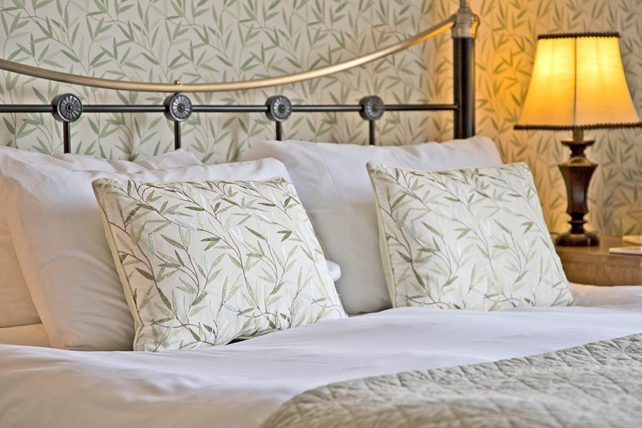 Thistle cushions on double bed
