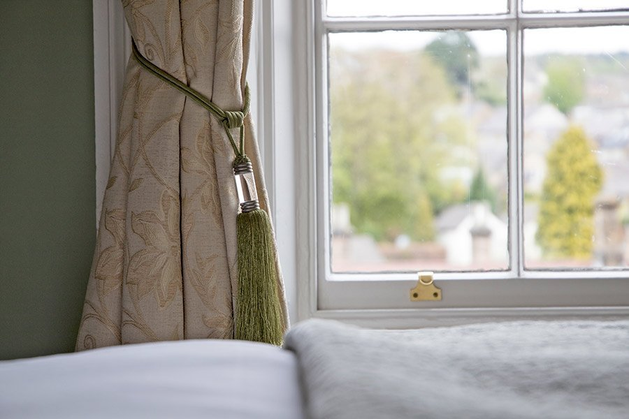 Curtain with green tieback