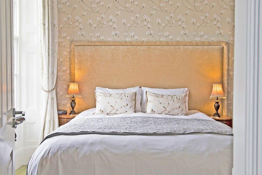 View of double bed with door open