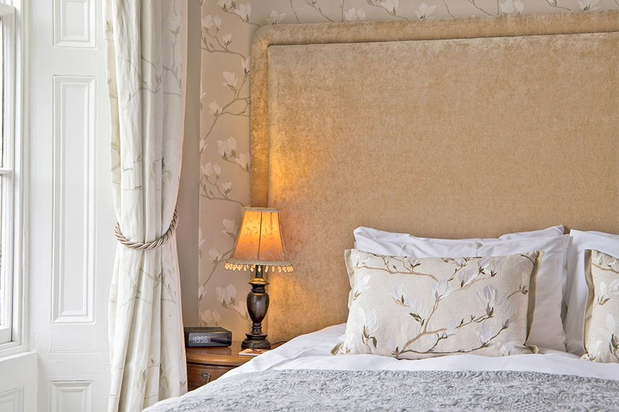 Double bedroom with bedside lamp