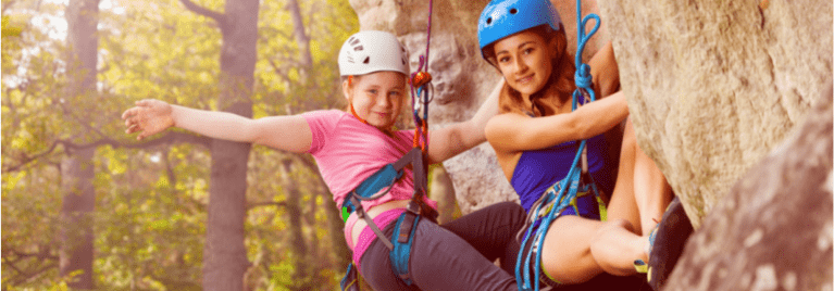 2 girls abseiling in Derbyshire