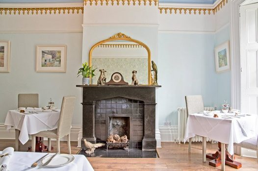 Victorian fireplace in dining room