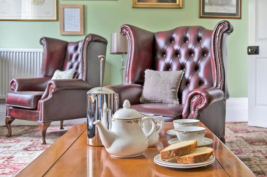 Guest Lounge with a pot of coffee and cake