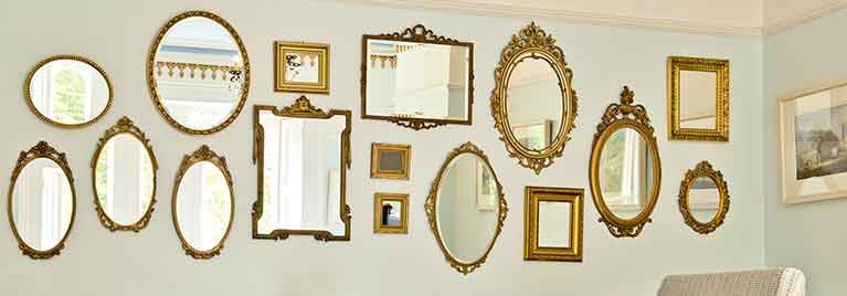 Gold mirrors on dining room wall