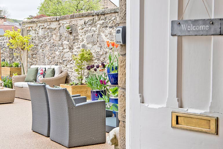 Door open to garden with a welcome sigh